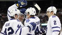 Toronto Maple Leafs right wing Joey Crabb (46) celebrates with teammates after scoring a goal during the second period against the New York Islanders at Nassau Veterans Memorial Coliseum. Debby Wong-US PRESSWIRE (Debby Wong/US PRESSWIRE)