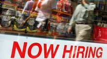 "Pedestrians walk past a ""Now Hiring"" sign in the window of a GNC shop in Boston, Massachusetts in this file image. (BRIAN SNYDER/BRIAN SNYDER/REUTERS)"