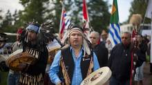 A procession of residential school survivors during the Truth and Reconciliation Commission national event in Vancouver, Wednesday, Sept. 18, 2013. (Rafal Gerszak For The Globe and Mail)