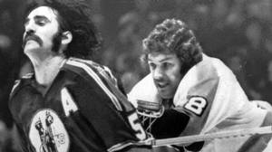 Philadelphia Flyers' Dave Schultz (right) crosschecks Kansas City Scouts' Brent Hughes just before sparking a fight in this April, 1975 file photo. Nearly four decades after the Broad Street Bullies roamed the ice, the muscled-up moniker still has a loose affiliation with the Philadelphia Flyers. The Bullies will be remembered in the documentary