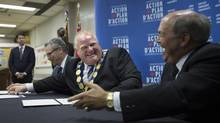Toronto Mayor Rob Ford, middle, shares a laugh with Association of Municipalities of Ontario President Russ Powers at a Toronto news conference on July 11 2014, where federal Finance Minister Joe Oliver, left, announced a gas-tax fund renewal for Ontario municipalities. (FRED LUM/THE GLOBE AND MAIL)