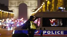 Police secure the Champs Elysees Avenue after one policeman was killed and another wounded in a shooting incident in Paris, France, on April 20, 2017. (CHRISTIAN HARTMANN/REUTERS)