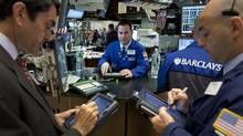 Traders work on the floor of the New York Stock Exchange on Tuesday, June 26, 2012. (Scott Eells/Bloomberg)