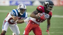 Montreal Alouettes' Tyree Hollins (26) tackles Calgary Stampeders' Kamar Jorden during first half CFL football action in Montreal, Friday, July 14, 2017. (Graham Hughes/THE CANADIAN PRESS)