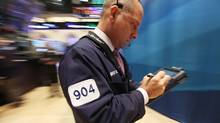 Traders work on the floor of the New York Stock Exchange in morning trading on August 9, 2011 in New York City. (Mario Tama/Getty Images)