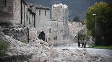 Policemen stand by collapsed wall of the village of Norcia, on October 31, 2016, a day after a 6.6 magnitude earthquake hit central Italy. It came four days after quakes of 5.5 and 6.1 magnitude hit the same area. Sunday's earthquake was the most powerful earthquake recorded in Italy in 36 years. (FILIPPO MONTEFORTE/AFP/Getty Images)