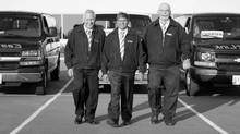EastLink Door-to-Door Shuttle Express Inc. founder and president Georges Le Roc, centre, flanked by drivers Peter Arsenault, left, and George Hannah. (Dolores Breau/Courtesy of EastLink)