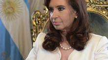 "Argentina's President Cristina Fernandez de Kirchner addresses the nation from Government House in Buenos Aires June 16, 2014, in this handout courtesy of the Argentine Presidency. Fernandez said in a nationwide televised speech on Monday that Argentina would honor its payments to holders of its restructured debt and so avoid a default despite suffering a setback in its long-running legal battle against ""holdout"" investors. The U.S. Supreme Court earlier on Monday declined to hear Argentina's appeal over its battle with hedge funds that refused to take part in its debt restructurings. The court's decision was unexpected and risks toppling Latin America's No 3 economy into a new default. REUTERS/Argentine Presidency/Handout via Reuters (ARGENTINA - Tags: BUSINESS POLITICS) ATTENTION EDITORS – THIS PICTURE WAS PROVIDED BY A THIRD PARTY. REUTERS IS UNABLE TO INDEPENDENTLY VERIFY THE AUTHENTICITY, CONTENT, LOCATION OR DATE OF THIS IMAGE. FOR EDITORIAL USE ONLY. NOT FOR SALE FOR MARKETING OR ADVERTISING CAMPAIGNS. THIS PICTURE IS DISTRIBUTED EXACTLY AS RECEIVED BY REUTERS, AS A SERVICE TO CLIENTS (HANDOUT/REUTERS)"