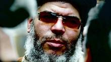Radical Muslim Cleric Abu Hamza looks on having conducted a service of Friday afternoon prayers outside the Finsbury Park Mosque March 28, 2003 in London. The controversial cleric was arrested on May 27, 2004 in London on an extradition warrant issued by the US. (Hugo Philpott/Hugo Philpott/Getty Images)