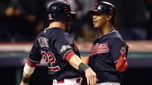Cleveland Indians shortstop Francisco Lindor (right) celebrates with second baseman Jason Kipnis after hitting a two-run home run in Game 1 of the ALCS. (Charles LeClaire/USA Today Sports)