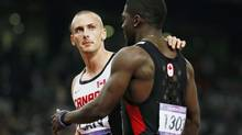 Canada's Jared Connaughton (L) and Justyn Warner react after the men's 4x100m relay final at the London 2012 Olympic Games at the Olympic Stadium August 11, 2012. Canada finished third but were disqualified. (LUCY NICHOLSON/REUTERS)
