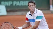 Canada's Daniel Nestor returns the ball at the Roland Garros stadium, Saturday June 4, 2011 in Paris. (Lionel Cironneau/AP/Lionel Cironneau/AP)