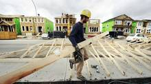 A construction worker works on building new homes in Calgary, May 31, 2010. On Tuesday, Canada will report its GDP for May, 2012, and economists expect growth of 0.3 per cent. (TODD KOROL/REUTERS/TODD KOROL/REUTERS)