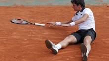 Milos Raonic of Canada falls during his match against Juan Monaco of Argentina during the French Open tennis tournament at the Roland Garros stadium in Paris June 2, 2012. (GONZALO FUENTES/REUTERS)