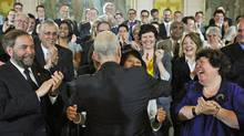 NDP Leader Jack Layton hugs his wife, Toronto MP Olivia Chow, after speaking to his caucus in Ottawa on May 24, 2011. (Sean Kilpatrick/THE CANADIAN PRESS)