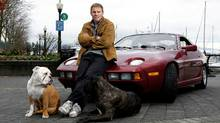 Ross Rebagliati with Logan (L) and Emma and his 1984 Porsche 928 in Vancouver. (Lyle Stafford/Lyle Stafford/THE GLOBE AND MAIL)