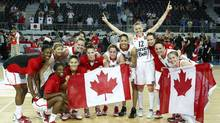 Canada's players pose for a photo as they celebrate their victory against Japan during their 2012 women's FIBA Olympic Qualifying Tournament in Ankara July 1, 2012. Canada won the match and qualified for the London 2012 Olympic Games (REUTERS)