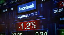 Monitors show Facebook stock during trading at the NASDAQ. (ERIC THAYER/REUTERS)