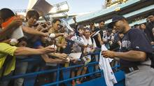 New York Yankees closer Mariano Rivera signs autographs at the Rogers Centre before his team plays the Toronto Blue Jays in MLB American League baseball action in Toronto, Thursday September 19, 2013. Rivera has said he plans to retire after the season and it will be the last game he plays at the Rogers Centre. (MARK BLINCH/THE CANADIAN PRESS)