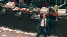 An exhausted trader slumps in his chair at the Toronto Stock Exchange in this Oct. 19, 1987, known as Black Monday. (Tim Clark/The Canadian Press/Canadian Press)