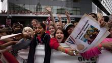 Crowds cheer at Maple Leafs Square in Toronto during a parade celebrating Canada's Olympic athletes. (Moe Doiron/The Globe and Mail)