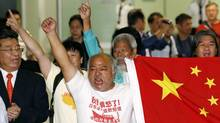 Chinese activists who were deported from Japan, Bull Tsang Kin-shing, center at the front, and Koo Sze-yiu, center at the back, shout slogan after arriving in Hong Kong international airport Friday, Aug. 17, 2012. Seven of 14 Chinese activists arrested after landing on disputed islands left Japan by plane Friday and the others were being deported as well, relieving some tension from one of the territorial rows Tokyo has with its neighbors. (Kin Cheung/AP)