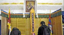 A portrait of the Dalair Lama watches over Canadian Tibetans as they vote for a new leader in exile, in Toronto, March 20, 2011. (J.P. Moczulski for The Globe and Mail) (J.P. MOCZULSKI/J.P. MOCZULSKI)