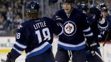 Winnipeg Jets' Blake Wheeler (26) celebrates with Bryan Little (18) after Wheeler scored early in the second period against the Toronto Maple Leafs' during NHL hockey action in Winnipeg, Tuesday, March 12, 2013. (Trevor Hagan/The Canadian Press)