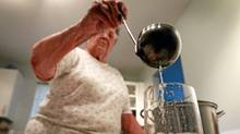 White Rock, B.C., resident Norma Jackson pours herself a glass of boiled water. (Darryl Dyck for The Globe and Mail/Darryl Dyck for The Globe and Mail)