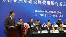China's Finance Minister Lou Jiwei (L) gives a speech, with the guests of the signing ceremony of the Asian Infrastructure Investment Bank at the Great Hall of the People in Beijing October 24, 2014. (Takaki Yajima/Reuters)