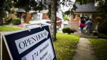 People visit an open house for sale in Toronto, Friday July 14, 2017. (Mark Blinch/Globe and Mail)