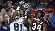 Ottawa RedBlacks' Jonathan Rose prevents Toronto Argonauts' Tori Gurley from catching a pass during second half CFL action on Friday, Sept. 23, 2016 in Ottawa. (Justin Tang/THE CANADIAN PRESS)