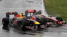 Red Bull's Mark Weber, left, and McLaren's Lewis Hamilton drive into the Senna corner at the Canadian Grand Prix last year. (Tom Boland/THE CANADIAN PRESS)