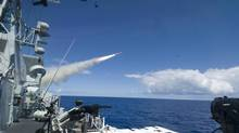 A Harpoon missile launches from the deck of Her Majesty's Canadian ship Regina during a live fire exercise July 14. Halifax-class frigates Ottawa and Regina each fired two Harpoon anti-ship missiles at a decommissioned Navy ship under controlled conditions at the Pacific Missile Firing Range off Hawaii. (MC1 Kirk Worley/CCGP RIMPAC)
