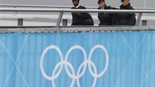Soldiers enter the Olympic Park in London. The city is planning a spotless showcase - but it is a risk that must be managed. At business schools, managing risk has become a hot topic. (Suzanne Plunkett/Reuters)