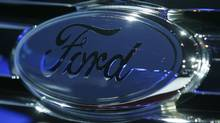 The grill emblem on the Ford Taurus X during its debut at the Chicago Auto Show in 2007. (John Gress/Reuters/John Gress/Reuters)