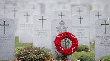 A wreath sits in front of a military gravestone in the National Military cemetary in Ottawa. (Adrian Wyld/THE CANADIAN PRESS)