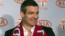 New Toronto FC head coach Ryan Nelsen smiles as he greets the media in Toronto on Tuesday January 8, 2013. (The Canadian Press)
