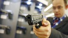 A visitor tests a Smith & Wesson gun model M&P9, 9mm, at the MILIPOL International State ESecurity Exhibition in Paris. (Regis Duvignau/Reuters)