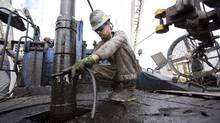 File photo of a worker at an oil well in Texas. (Michael Stravato/The New York Times)