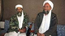 Osama bin Laden, left, sits with his adviser and purported successor Ayman al-Zawahri, an Egyptian linked to the al Qaeda network, on November 10, 2001. (REUTERS)