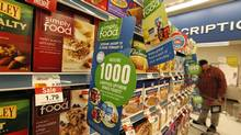 Customers shop in the grocery section of the Shoppers Drug Mart location in Toronto. (Deborah Baic/Deborah Baic)