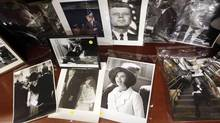Photos of former U.S. President John F. Kennedy and his wife Jacqueline Kennedy Onassis are displayed among other items as part of the McInnis Auctioneers Presidential Auction in Amesbury, Massachusetts in this file photo from February 10, 2013. (JESSICA RINALDI/Reuters)