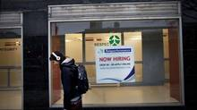 A job hire sign in the window of a telemarketing company, in downtown Thunder Bay. (Moe Doiron/The Globe and Mail)