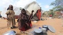 Kadija Mohamed cooks food for her children in a camp set up for internally displaced people in Dinsoor in southern Somalia, January 5, 2012. Almost six months after famine was declared in parts of Somalia, the Horn of Africa country remains in the grip of a humanitarian crisis with 4 million people in need of aid, according to UN figures. (Feisal Omar/REUTERS)