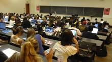 Computers, laptops and cellphones in class are distractions from the serious business of thinking, the authors argue. (Fred Lum/The Globe and Mail)