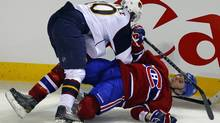 Atlanta Thrashers' Bryan Little hits Montreal Canadiens' Mathieu Darche (R) during the third period of NHL hockey action in Montreal January 2, 2011. (SHAUN BEST)