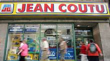 Pedestrians walk past a Jean Coutu pharmacy in Montreal. (RYAN REMIORZ/THE CANADIAN PRESS)