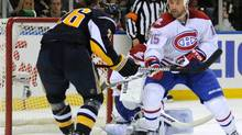 Buffalo Sabres left winger Thomas Vanek (L) misses the puck during a scoring chance in front of the Canadiens goal as Montreal center Glen Metropolit (R) closes during second period NHL hockey action in Buffalo, New York, March 24, 2010. REUTERS/Gary Wiepert (GARY WIEPERT)