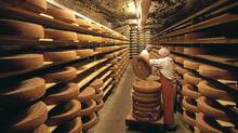 Cheesemakers brush Swiss cave-aged Gruyere cheese in a cave in Kaltbach, near Lucerne October 22, 2008. (Michael Buholzer/Michael Buholzer/REUTERS)